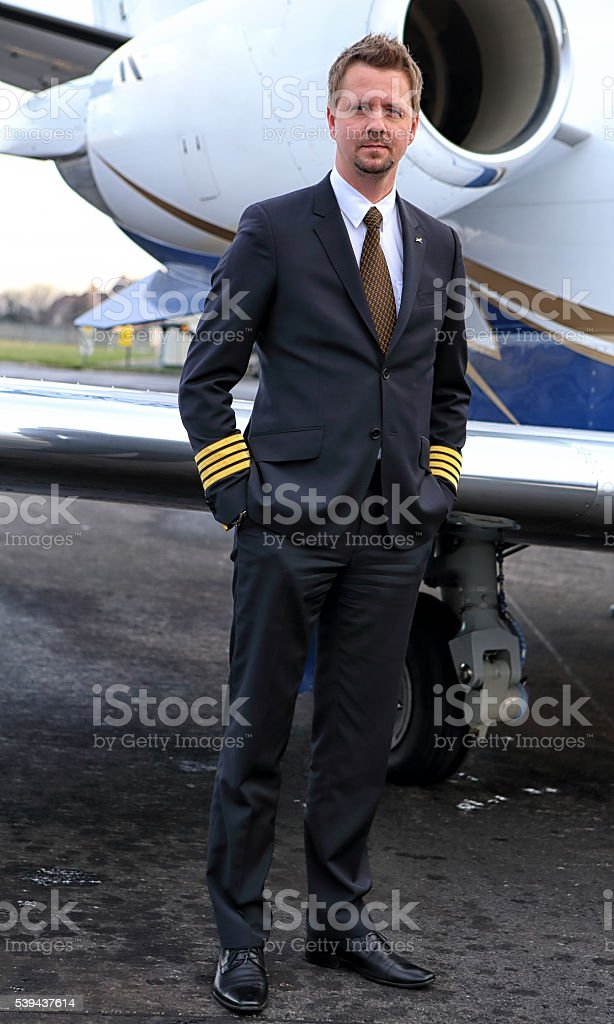 Pilot in command by wing of the plane stock photo