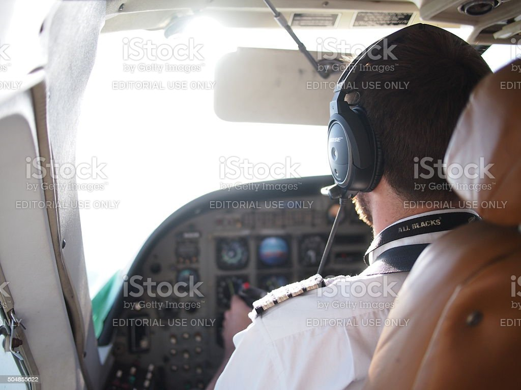 Pilot in propeller plane stock photo