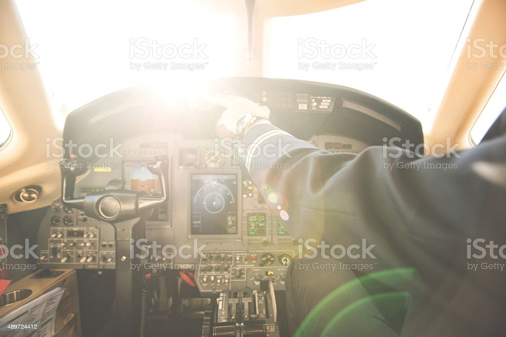 Pilot in the private jet airplane stock photo
