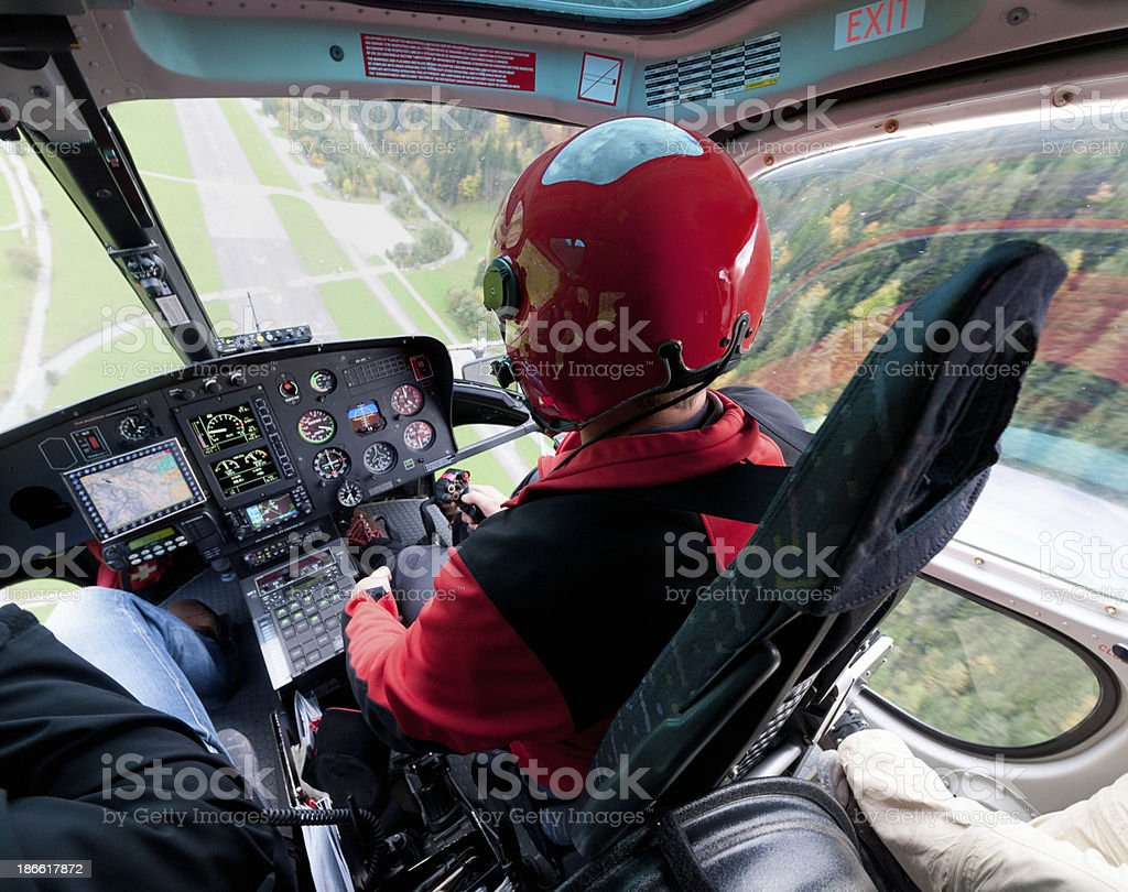 pilot landing helicopter on airfield stock photo