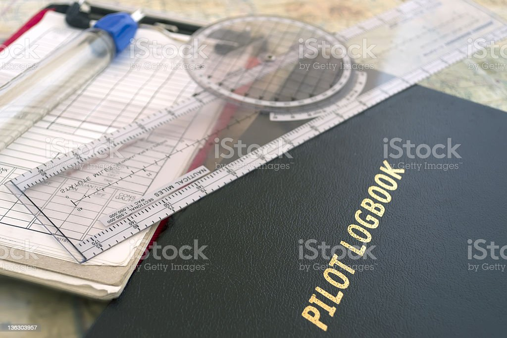 pilot logbook and tools stock photo
