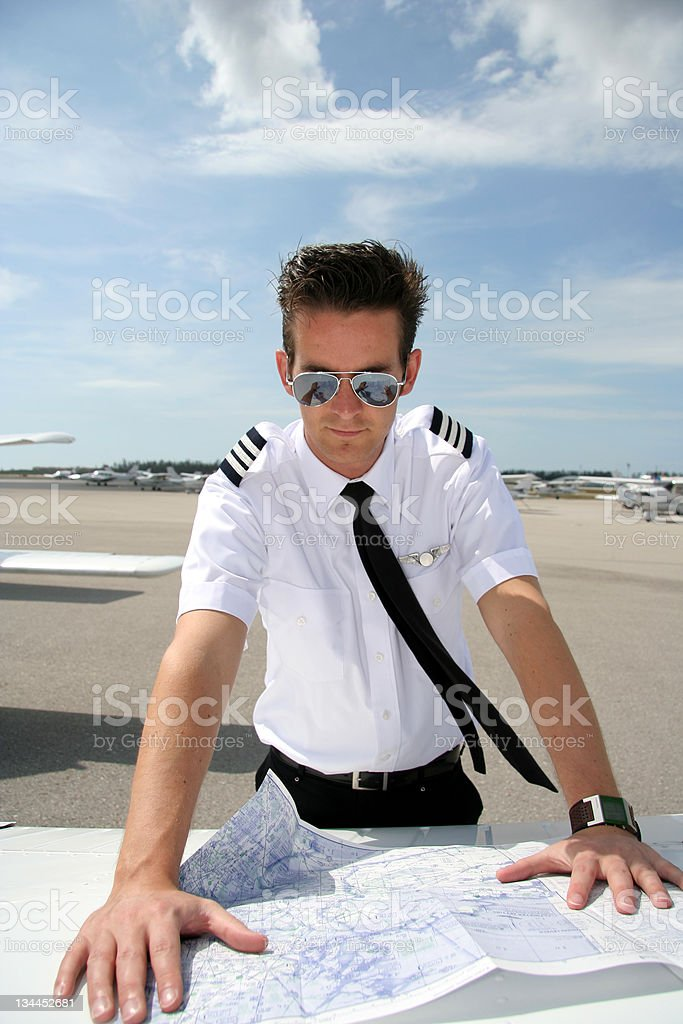 Pilot looking at chart royalty-free stock photo