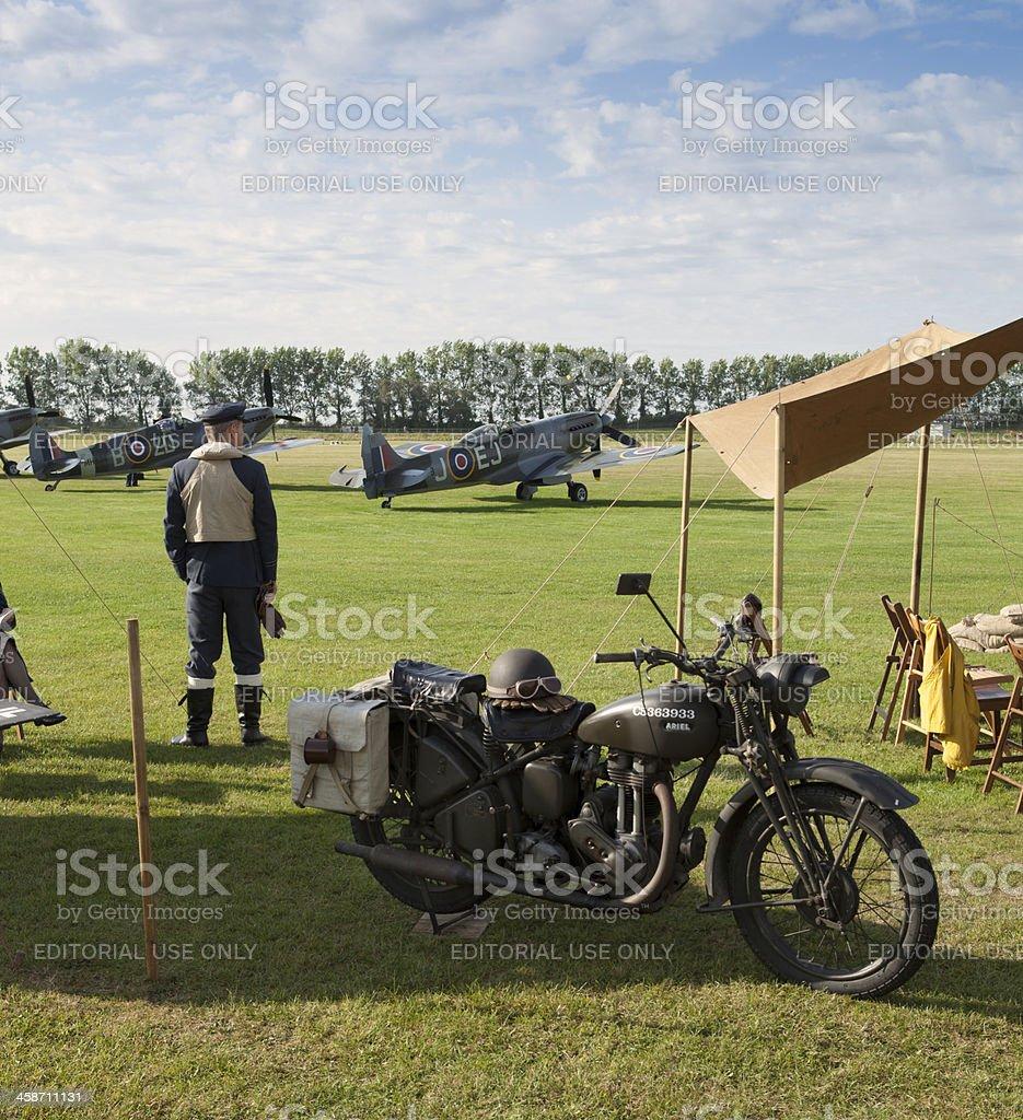 Pilot looks towards Spitfire aircraft stock photo