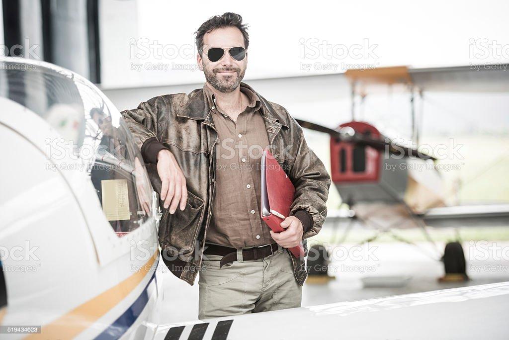 Pilot Next To His Airplane stock photo