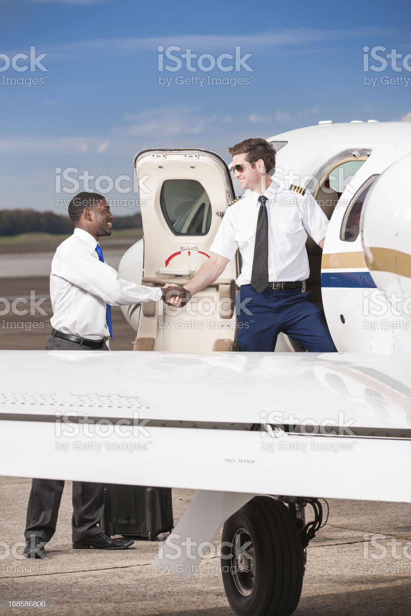 Pilot of Private Jet Greeting Business Traveler royalty-free stock photo