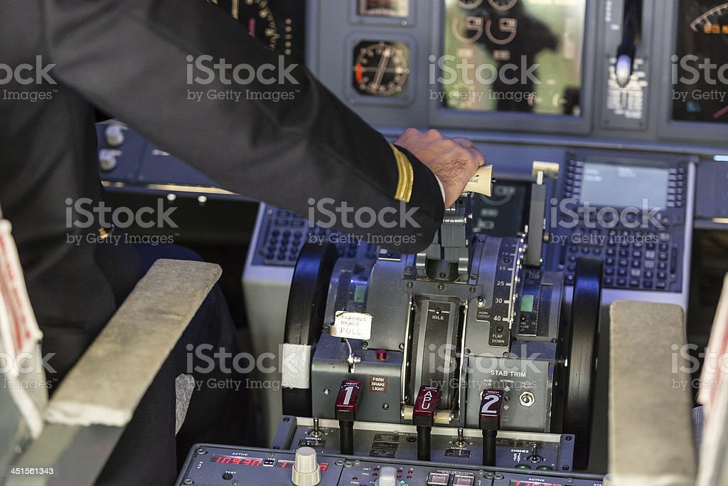 Pilot Operating the Throttle for Taking Off royalty-free stock photo