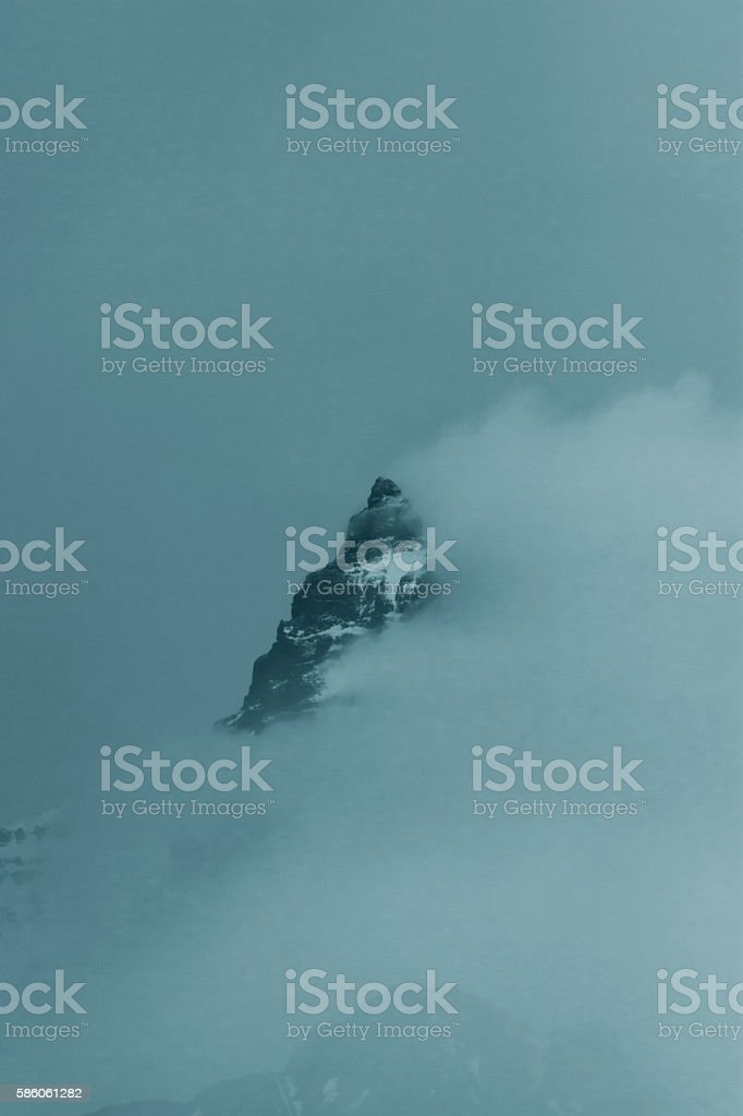 Pilot Peak in Mist and Clouds stock photo