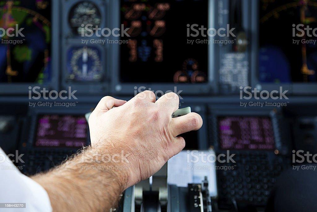 Pilot Pulling an Aircraft Throttle stock photo