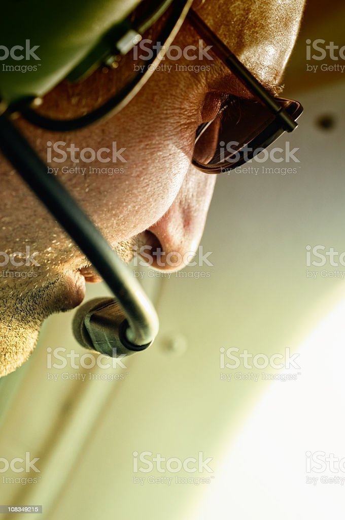 A pilot speaking to someone on his radio royalty-free stock photo