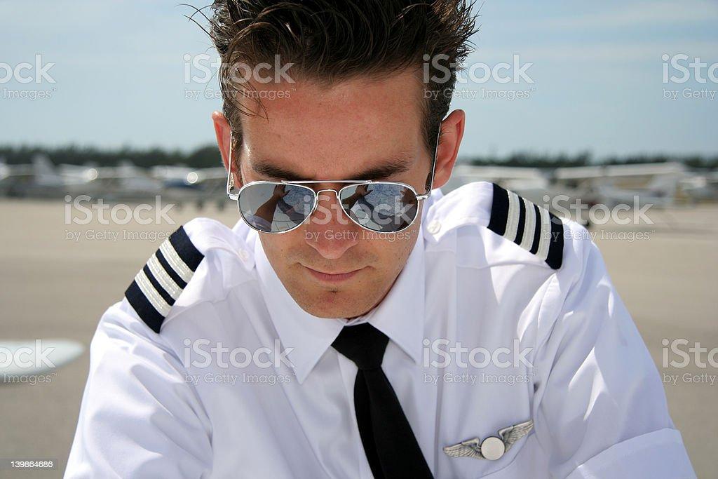 Pilot studying chart royalty-free stock photo