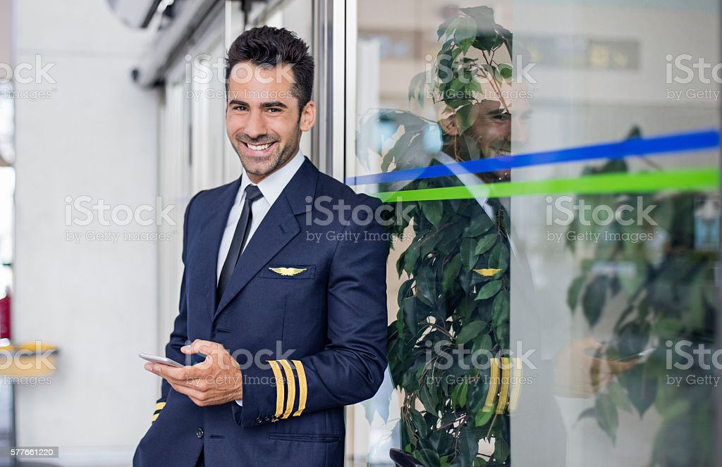Pilot waiting in the airport stock photo