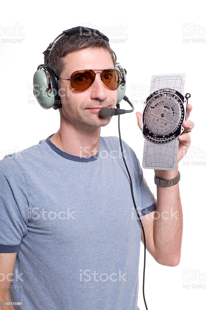 Pilot With a Flight Calculator stock photo