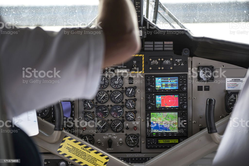 Pilot with Controls in Cockpit of Seaplane stock photo