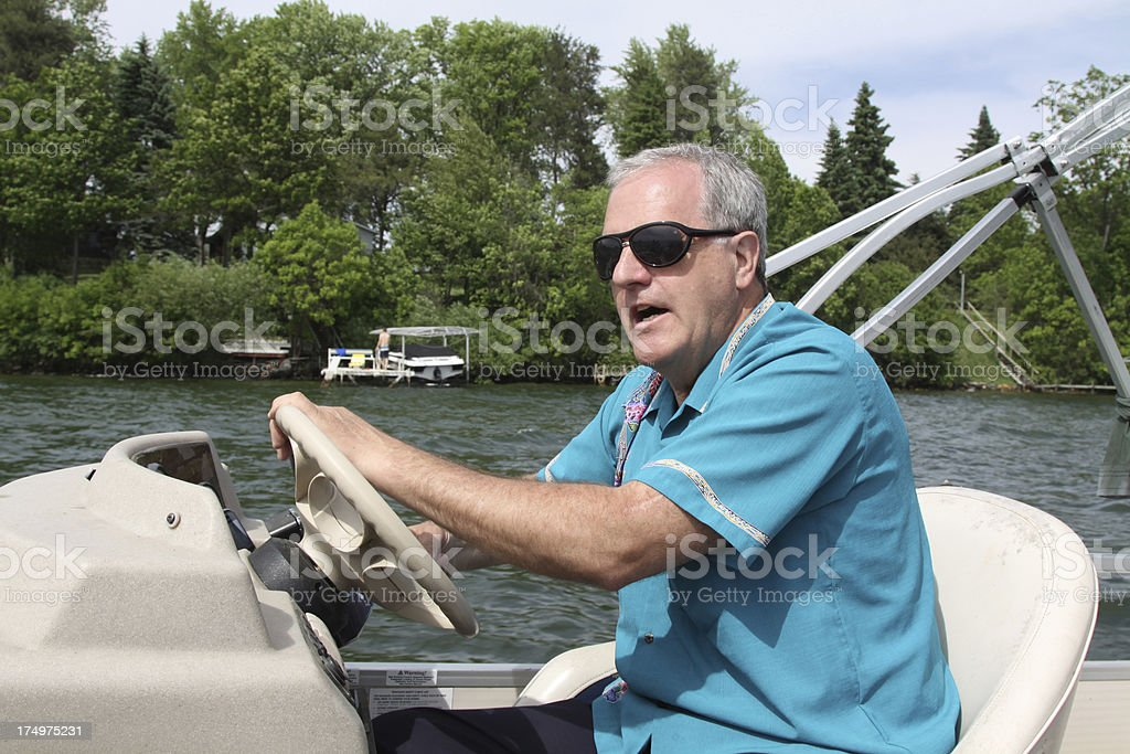 Piloting A Water Craft royalty-free stock photo
