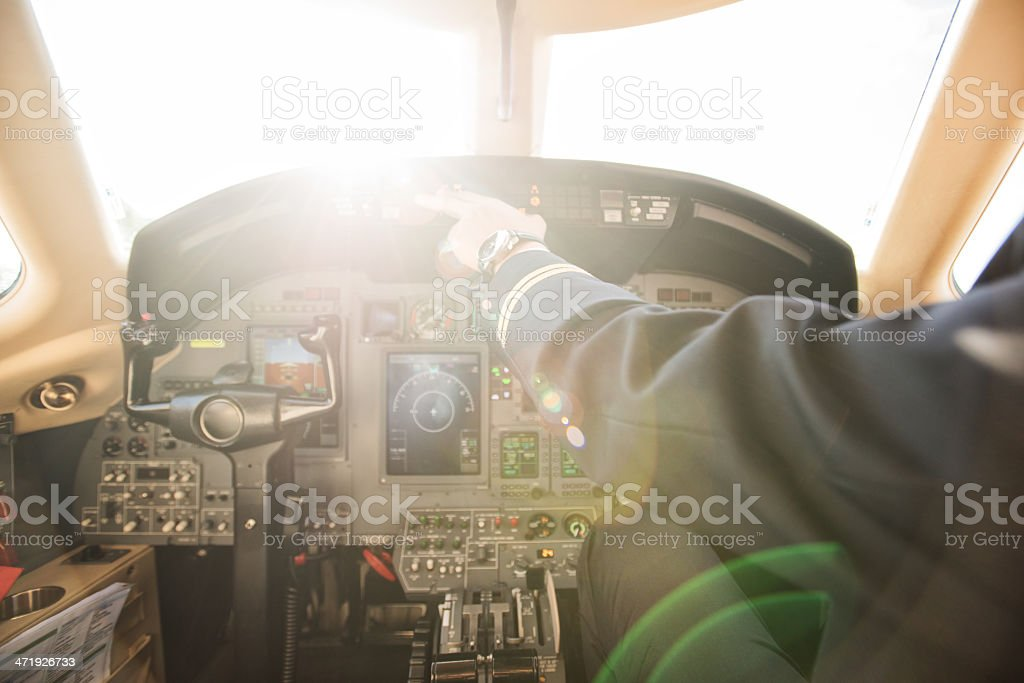 Piloting the private jet airplane stock photo