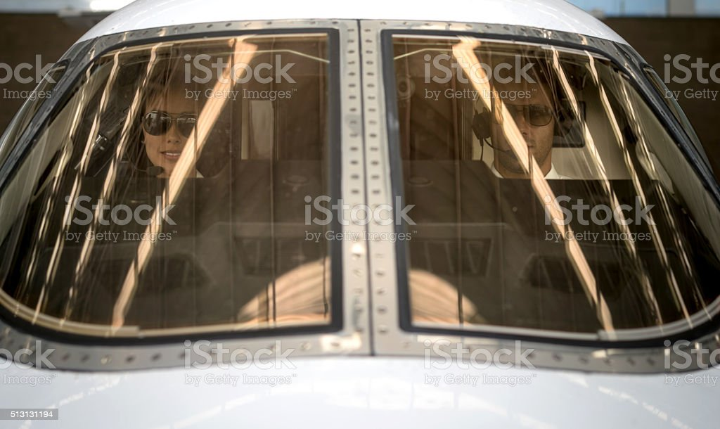 Pilots flying a private jet stock photo