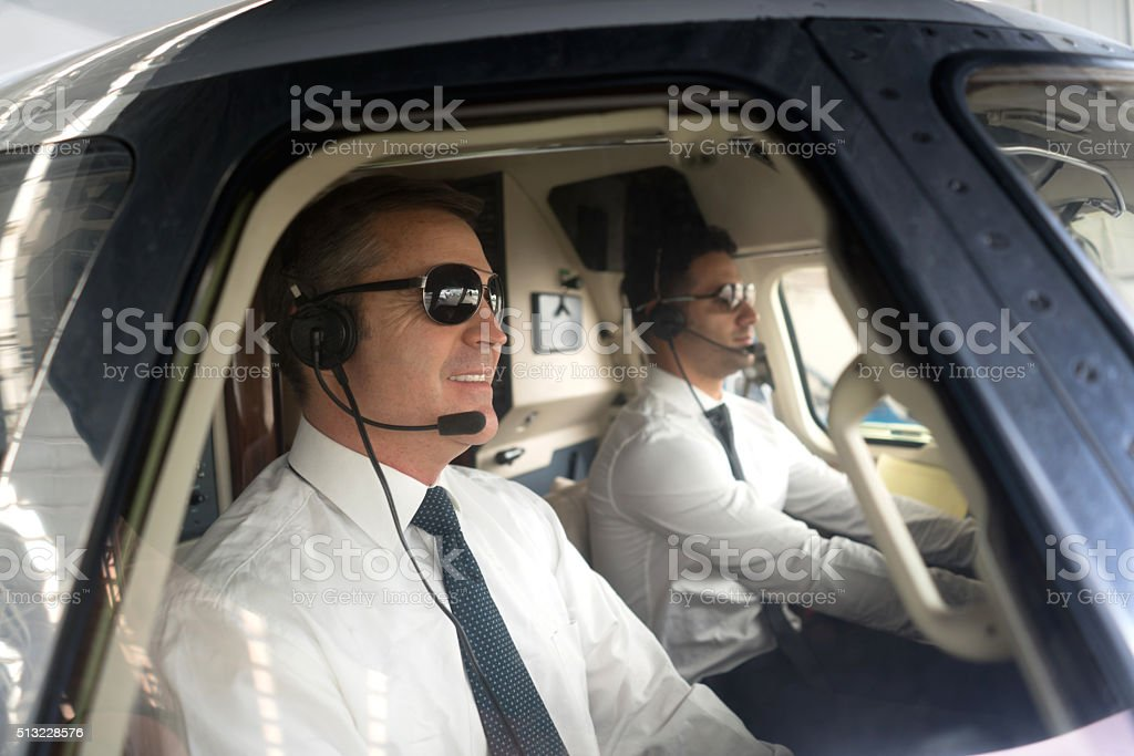Pilots flying an airplane stock photo