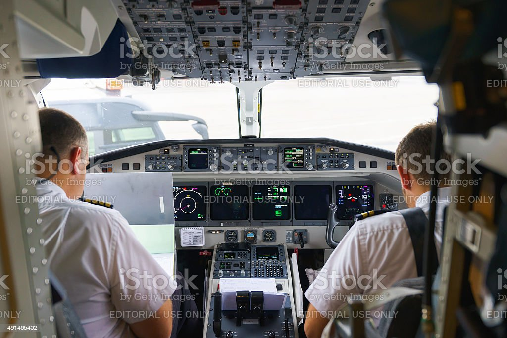 Pilots in aircraft cockpit stock photo