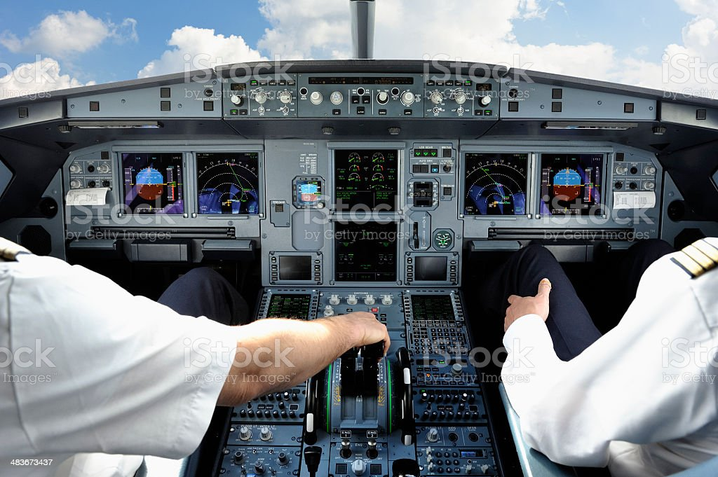Pilots in Cockpit of Modern Jet Aircraft stock photo