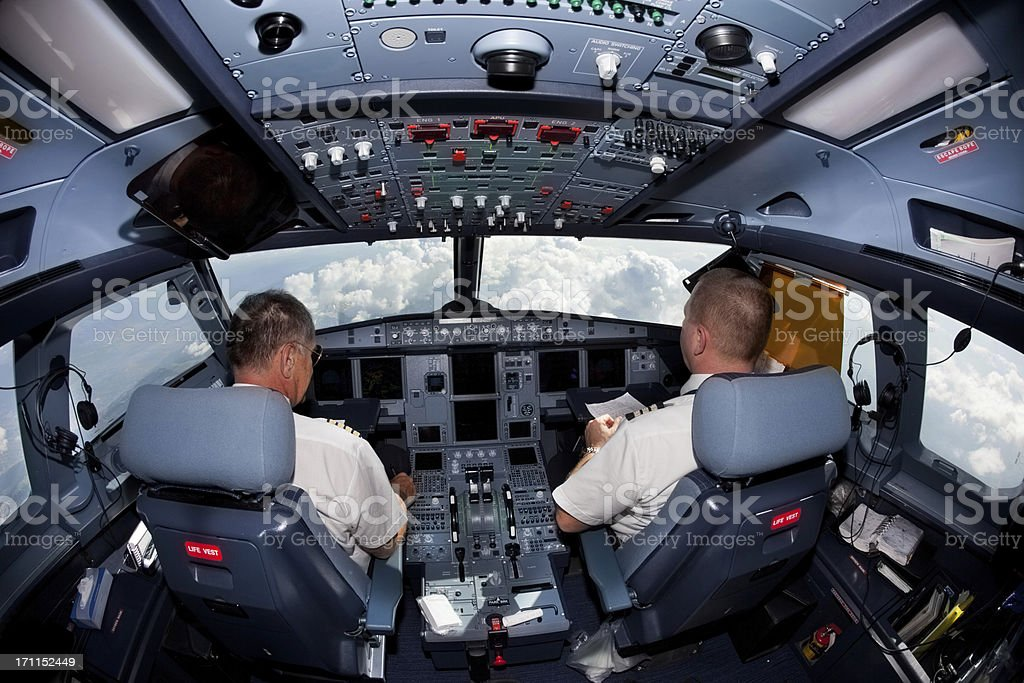 Pilots in the cockpit during a commercial flight stock photo