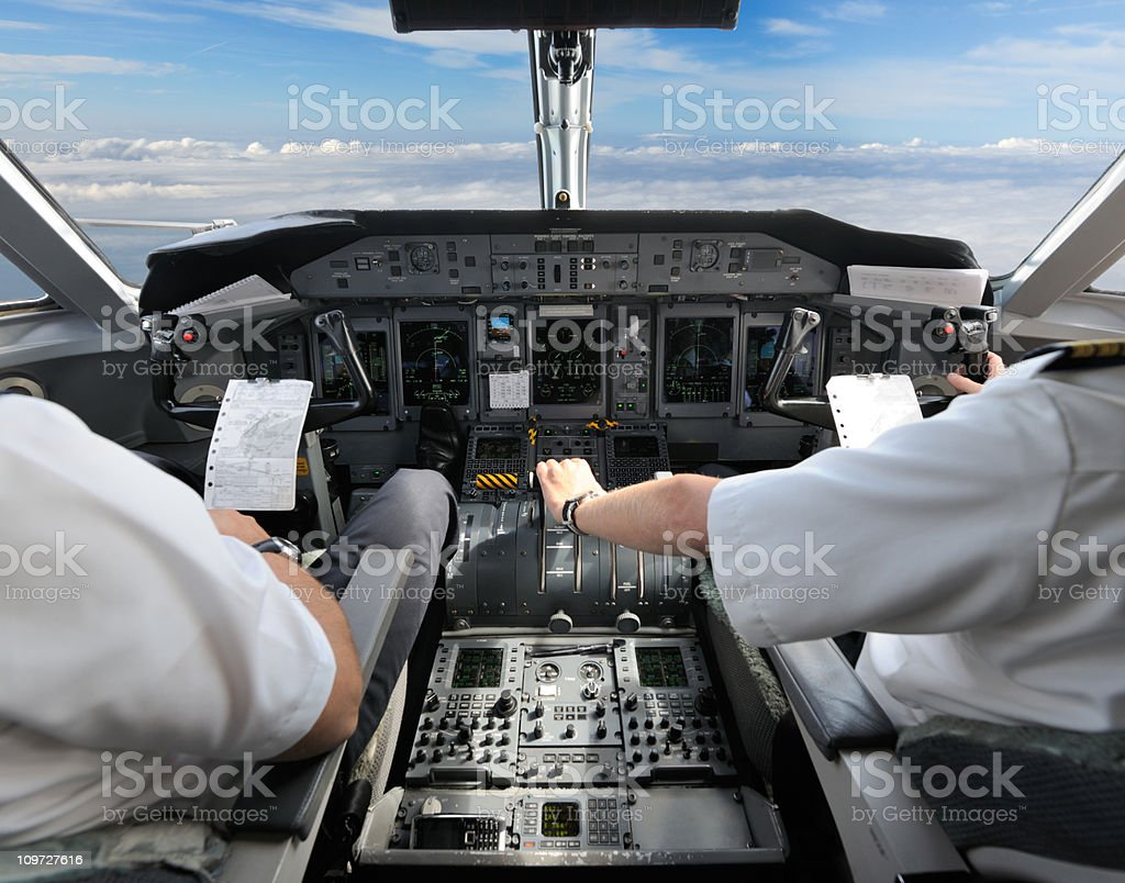 Pilots in the Cockpit - Preparing for Landing stock photo