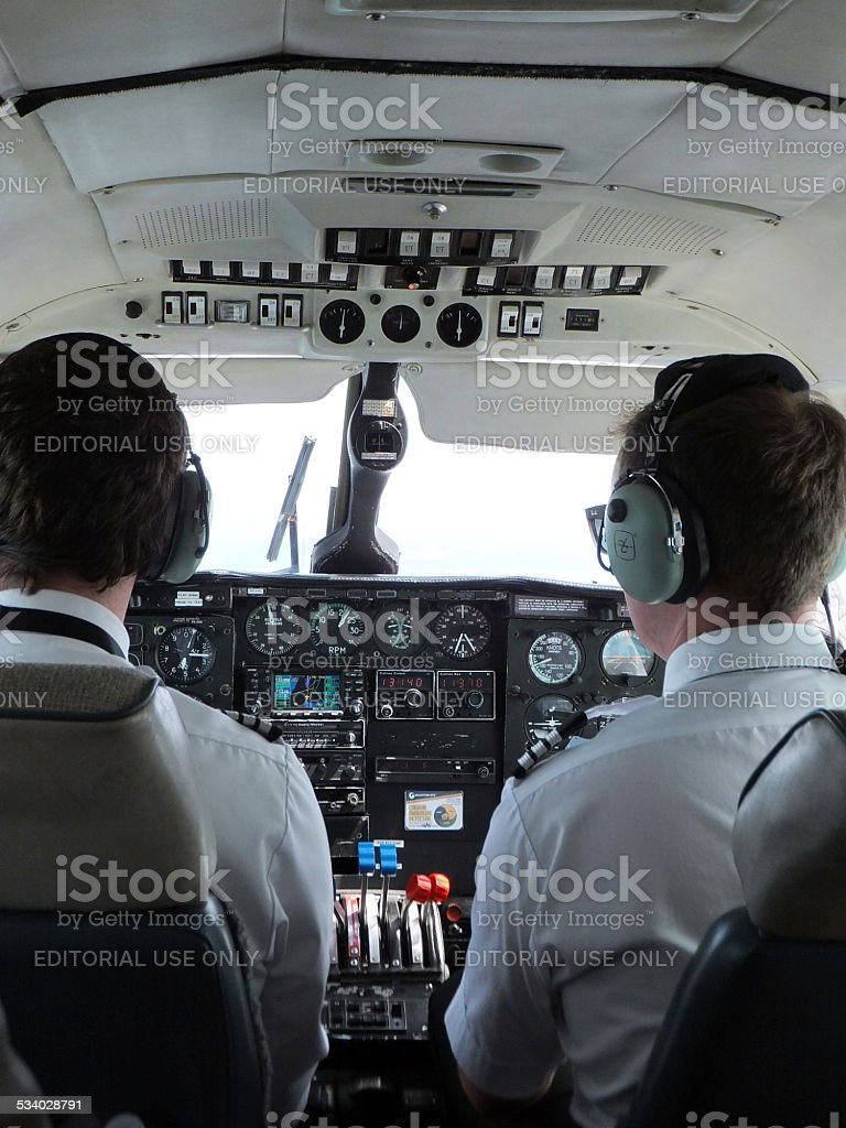 Pilots iside airplane cockpit stock photo