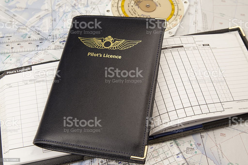 Pilots License logbook and map stock photo
