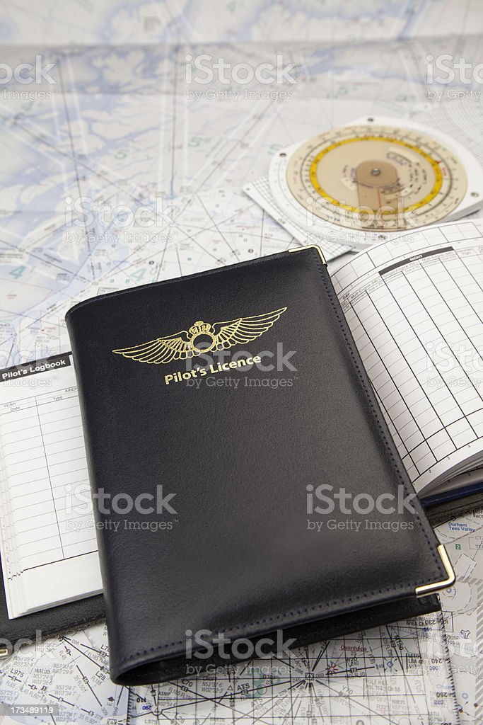 Pilots license with logbook and map royalty-free stock photo