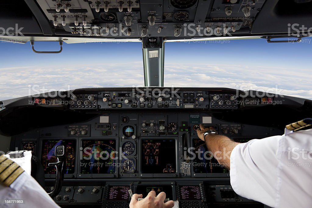 Pilots Working in an Aeroplane During a Commercial Flight stock photo