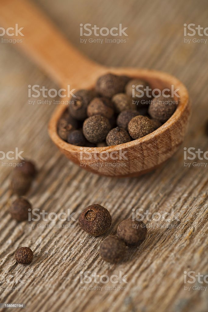 pimento in wooden spoon stock photo