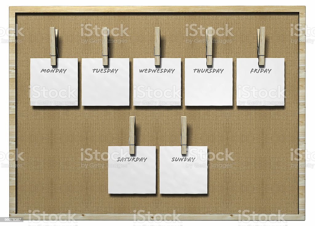 Pin board with days of the week held up by clothespins stock photo