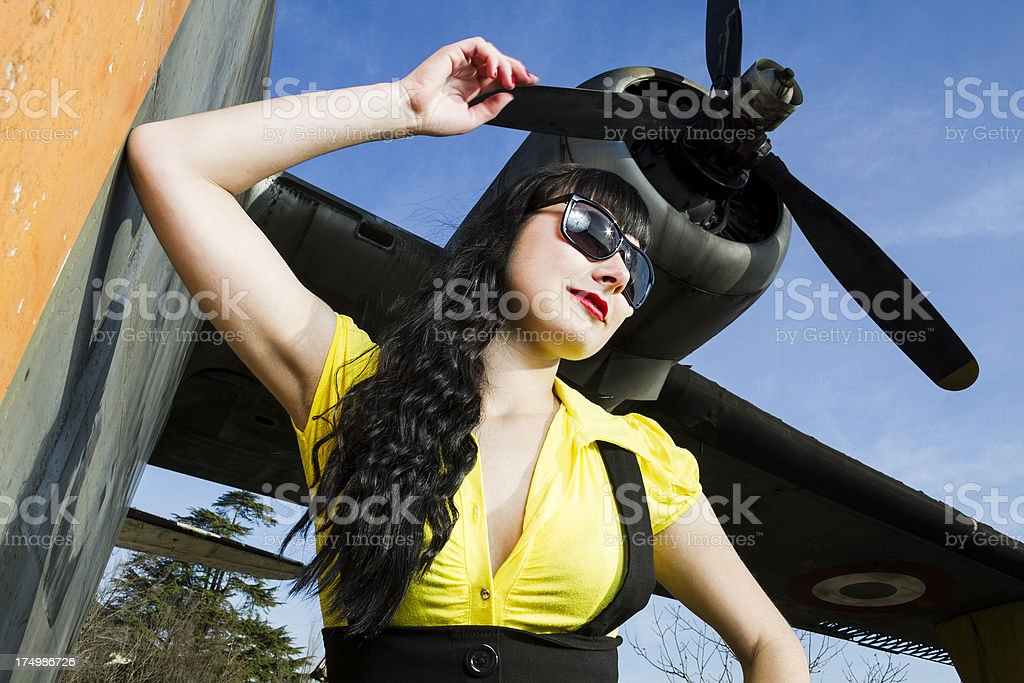Pin up girl by a plane stock photo