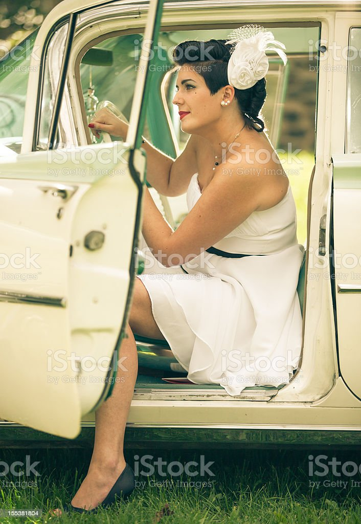 Pin up girl in the car royalty-free stock photo