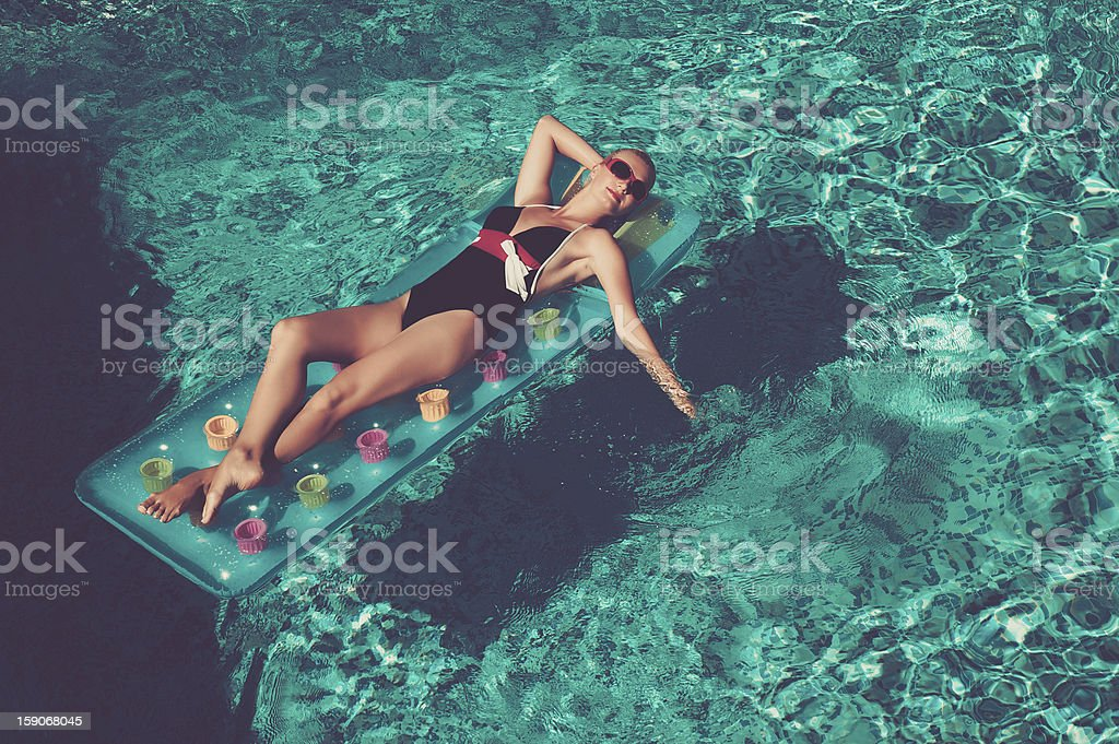 Pin up girl in the swimming pool royalty-free stock photo