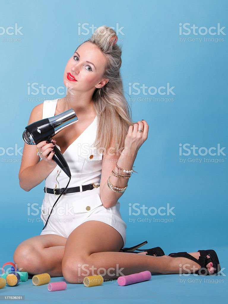 pin up girl retro style portrait woman drying hair royalty-free stock photo