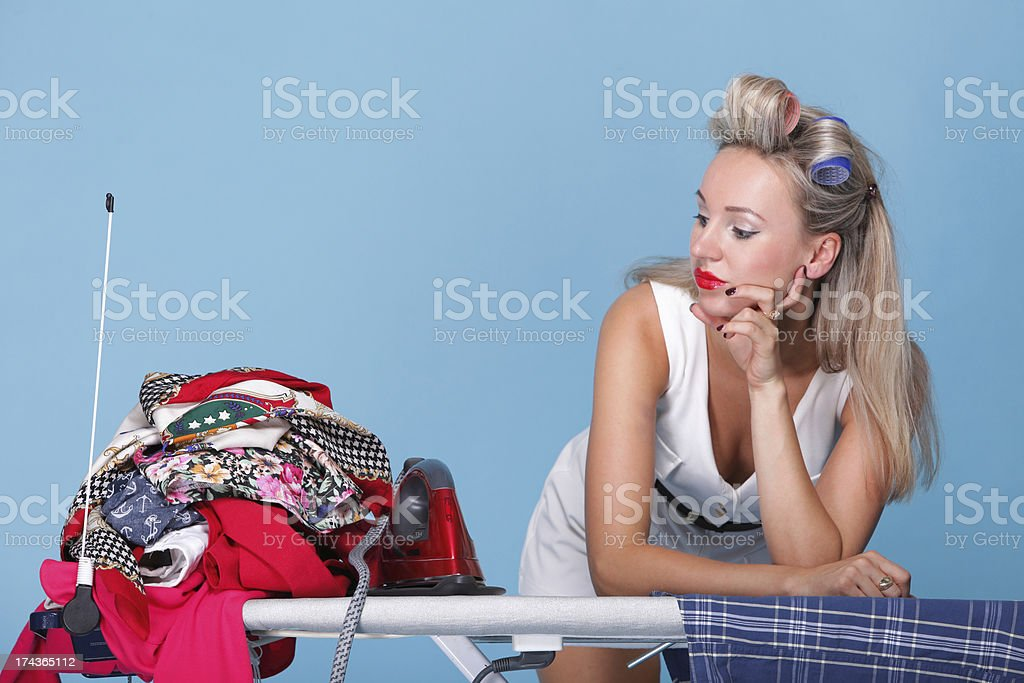 pin up girl retro style portrait woman ironing stock photo