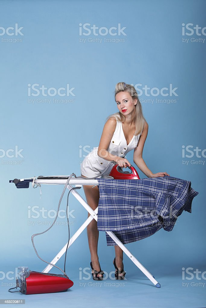pin up girl retro style portrait woman ironing royalty-free stock photo