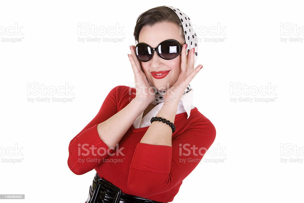 A pin up girl with a scarf on her head and big sunglasses royalty-free stock photo