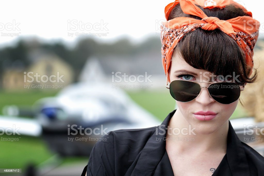 Pin up style woman at airfield stock photo