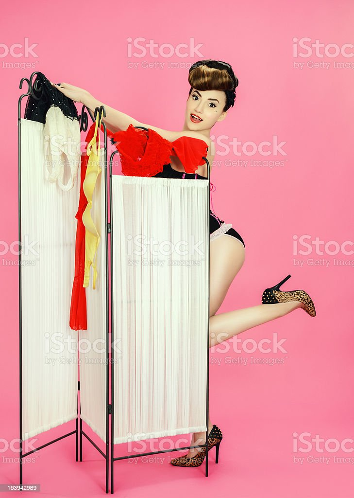 pin up woman changing clothes stock photo