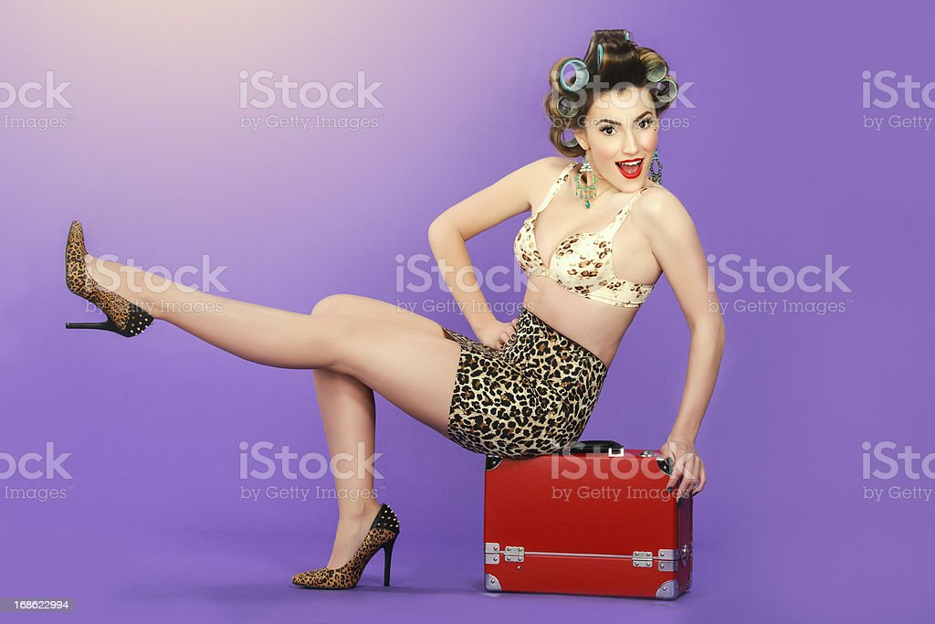 pin up woman posing on red luggage royalty-free stock photo
