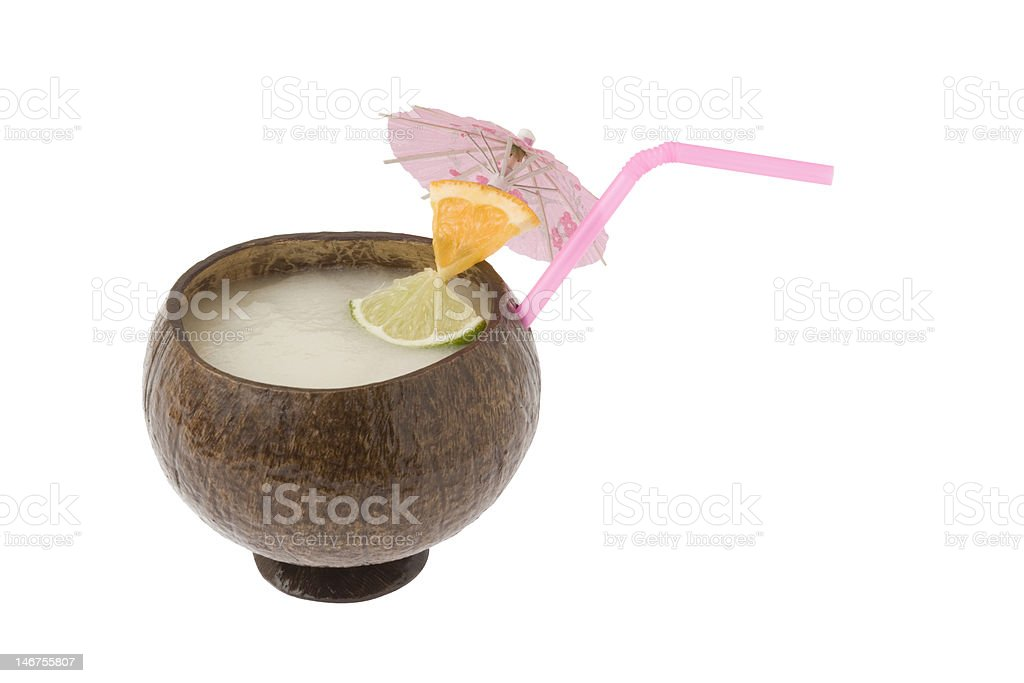 Pina colada cocktail in a coconut cup stock photo