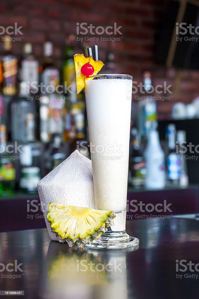 Pina Colada cocktail near on the  classic black bar table stock photo