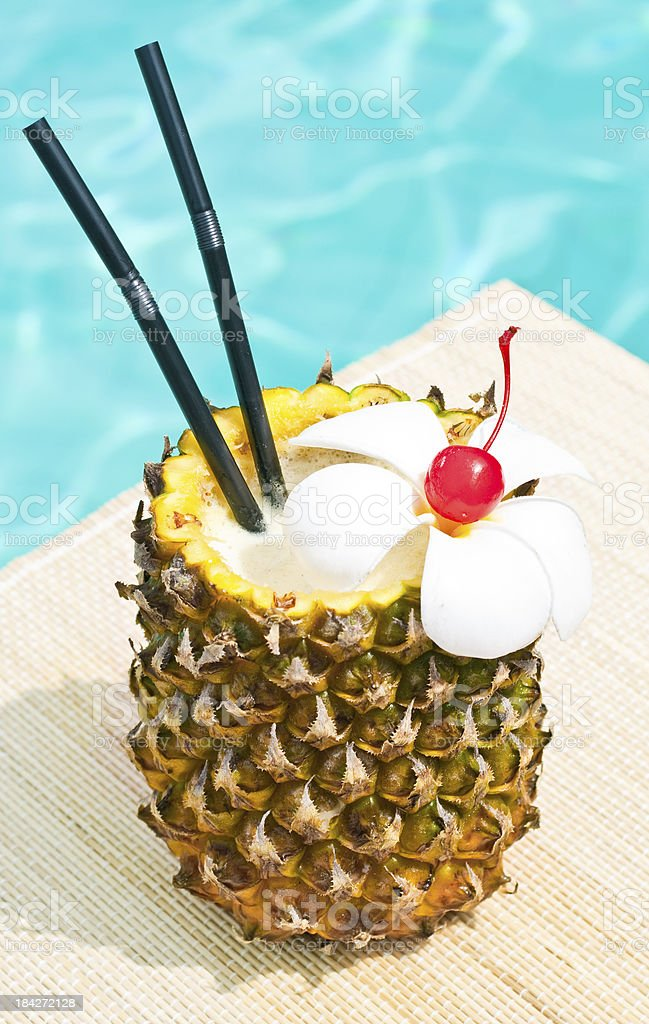Pina Colada cocktail near waterpool on the mat stock photo