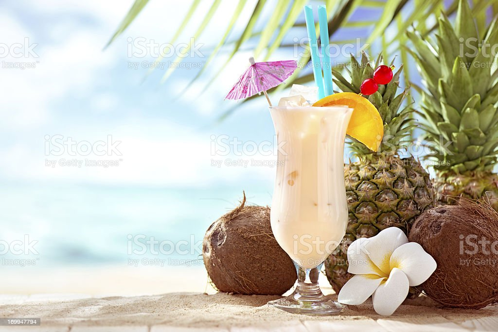 Pina Colada cocktail on the beach with copy space stock photo