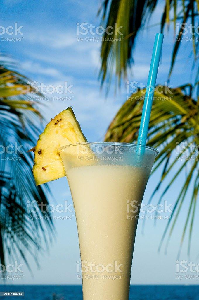 Pina colada on the beach. stock photo