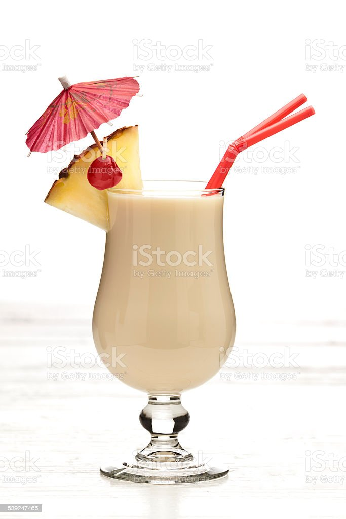 Pina colada tropical drink shot against white background stock photo