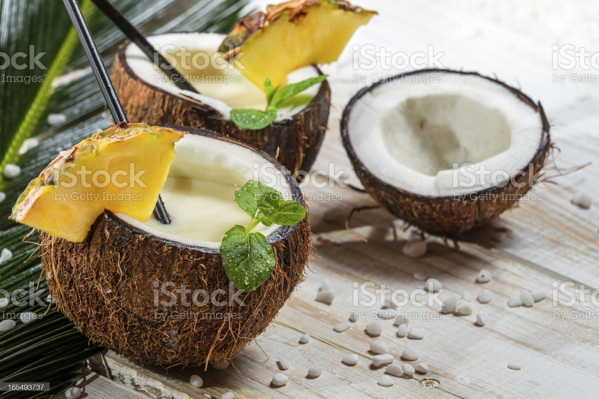 Pinacolada in a coconut on old white table royalty-free stock photo