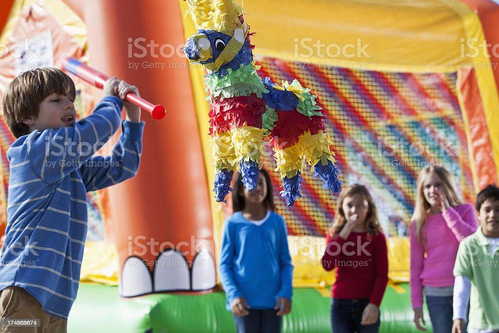 Pinata at children's birthday party royalty-free stock photo