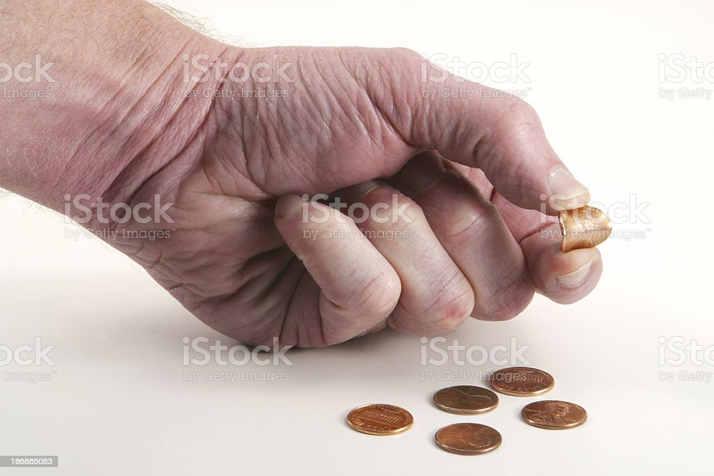 Pinching Pennies, Penny Finance. stock photo